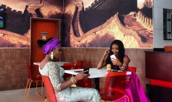 Two women and their cell phones in Lagos, Nigeria. @andrewesiebo