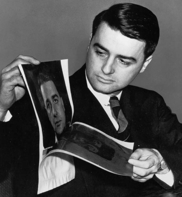 ** FILE ** Edwin H. Land, inventor of instant photography and founder of the Polaroid Corp. of Cambridge, Mass., peels apart a Polaroid photo of himself in 1947. Polaroid won court approval Friday, June 28, 2002, to sell substantially all of its assets to Bank One Corp.'s OEP Imaging Corp. OEP Imaging will pay Polaroid $255 million cash and assume roughly $200 million in liabilities. (AP Photo)